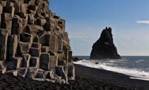 See the black lava beach in Iceland called Reynisfjara